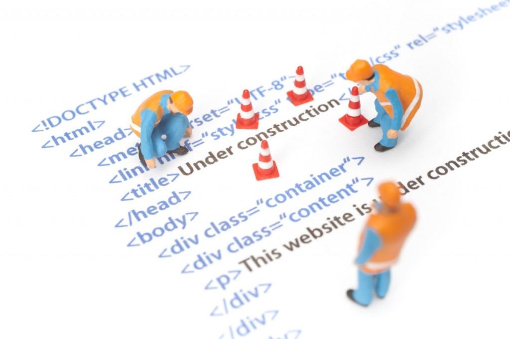 Website under construction mit Code - Fotolia_46385744_M